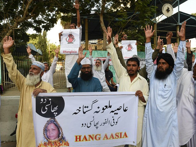 Pakistani protesters shout slogans against Asia Bibi, a Christian woman facing death sentence for blasphemy, at a protest in Karachi on October 13, 2016. Pakistan's Supreme Court delayed an appeal into the country's most notorious blasphemy case on October 13, against a Christian mother on death row since 2010, after …