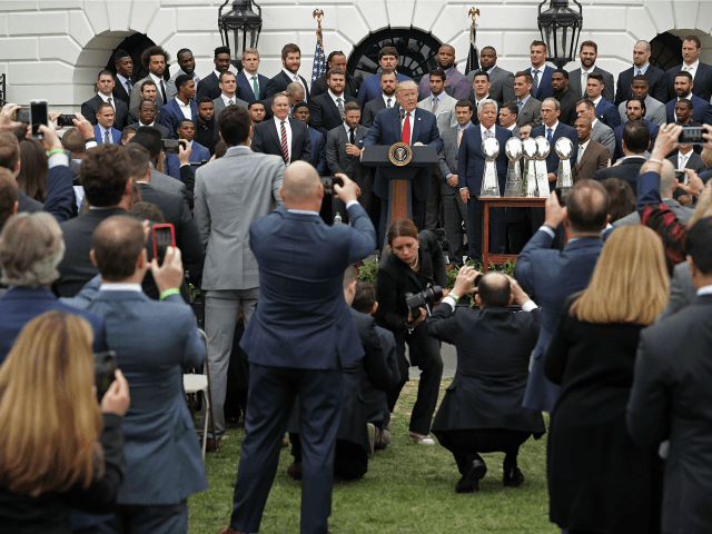 WASHINGTON, DC - APRIL 19: U.S. President Donald Trump delivers remarks while hosting the New England Patriots and team owner Robert Kraft during a celebration of the team's Super Bowl victory on the South Lawn at the White House April 19, 2017 in Washington, DC. It was the team's fifth …