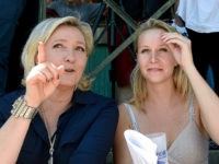 French far-right party Front National (FN) President and member of the European Parliament, Marine Le Pen (L) and FN party member of parliament Marion Marechal-Le Pen (R) react as they look on during a party meeting called 'Bleu blanc rouge Grand Sud' (BBR Grand Sud) on July 9, 2016 in …