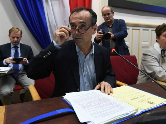 Beziers' mayor Robert Menard (C) leads a municipal council in Beziers, southern France, on October 18, 2016, during which a local referendum on the welcoming of migrants to the city was planned to take place at the end of the meeting. (Photo credit: SYLVAIN THOMAS/AFP/Getty Images)