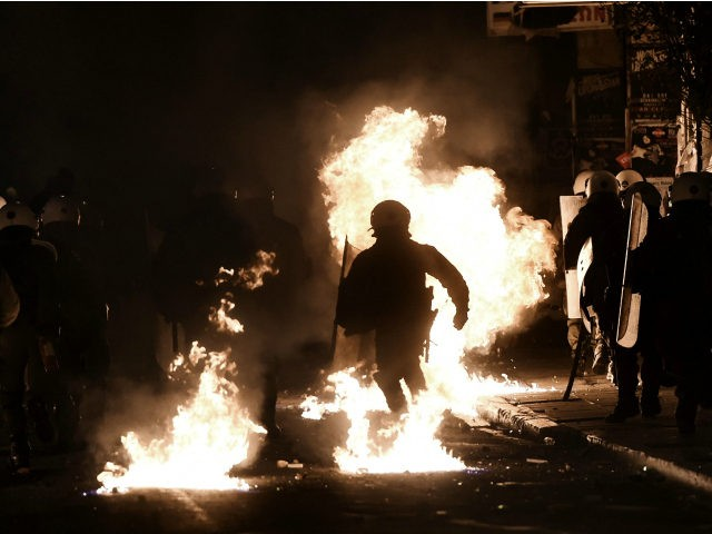 A molotov cocktail thrown by protesters explodes in front of riot police in the central district of Exarchia in Athens, on December 6, 2016, following a commemorative rally marking the eighth anniversary of the killing of teenager Alexandros Grigoropoulos by a Greek police officer. Hundreds of pupils, university students and …