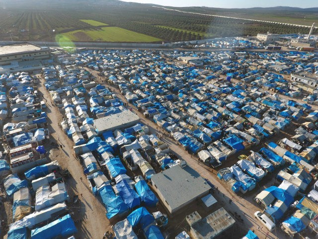 An aerial view shows the Bab al-Salama camp, set up outside the Syrian city of Azaz on Syria's northern border with Turkey on March 23, 2017. / AFP PHOTO / Zein Al RIFAI (Photo credit should read ZEIN AL RIFAI/AFP/Getty Images)