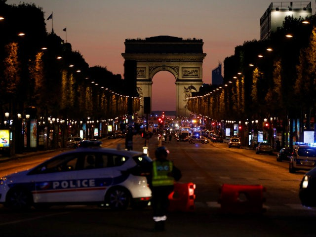 Police officers block the access to the Champs Elysees in Paris after a shooting on April 20, 2017. One police officer was killed and another wounded today in a shooting on Paris's Champs Elysees, police said just days ahead of France's presidential election. France's interior ministry said the attacker was …