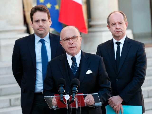 French Prime Minister Bernard Cazeneuve speaks next to Interior Minister Matthias Fekl (L) and Justice Minister Jean-Jacques Urvoas after a meeting of the Defense Council on April 21, 2017 at the Elysee Palace in Paris, after a gunman opened fire on police on the Champs Elysees. / AFP PHOTO / …