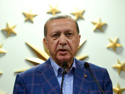 Turkish president Recep Tayyip Erdogan delivers a speech at the conservative Justice and Development Party (AKP) headquarters in Istanbul, on April 16, 2017, after the results of a nationwide referendum that will determine Turkey's future destiny. Erdogan on April 16, 2017 hailed Turkey for making a 'historic decision' as he …