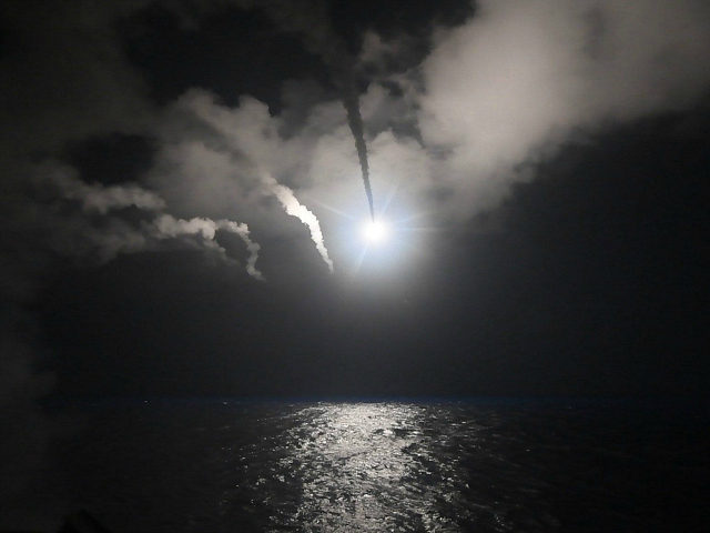 FILE - In this file image provided on Friday, April 7, 2017 by the U.S. Navy, the guided-missile destroyer USS Porter (DDG 78) launches a tomahawk land attack missile in the Mediterranean Sea. The U.S. missile attack has caused heavy damage to one of Syria's biggest and most strategic air …