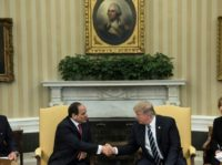 Translators watch as Egypt's President Abdel Fattah al-Sisi (L) and US President Donald Trump shake hands in the Oval Office before a meeting at the White House April 3, 2017 in Washington, DC