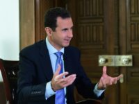 """I think what happened in Syria is a disgrace to humanity, and he's there, and I guess he's running things, so I guess something should happen,"" US President Donald Trump said of Syrian leader Bashar al-Assad, seen in 2016"