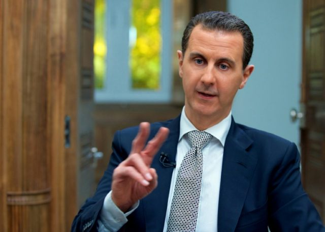 A handout picture released by the Syrian presidency's press office shows Syrian President Bashar al-Assad during an interview with AFP in the capital Damascus on April 12, 2017