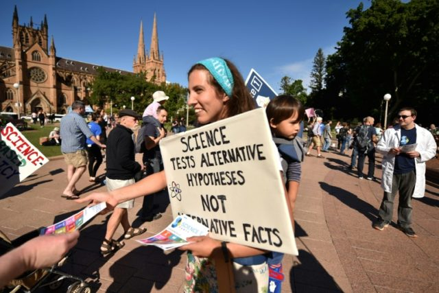 Supporters of science and research prepare to hand out leaflets as part of the March for Science protest in Sydney