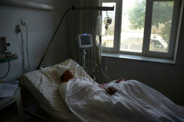 A wounded Afghan soldier in hospital in Mazar-i-Sharif on April 22, 2017, following a bloody Taliban attack on an army base