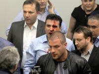 Opposition Social Democrats leader Zoran Zaev bleeding after being injured when supporters of Macedonia's former leading party entered the parliament and attacked MPs