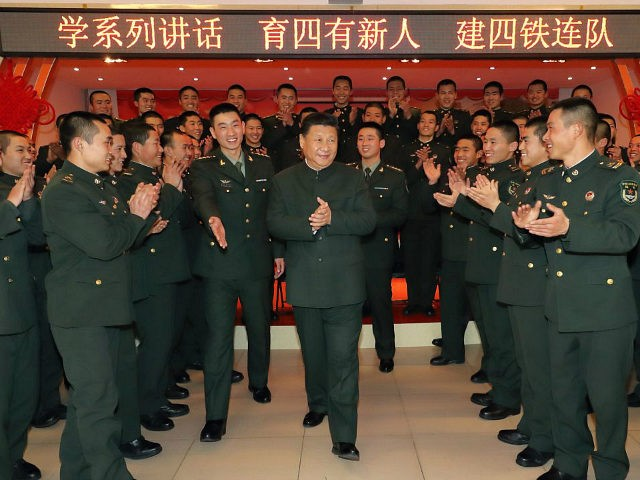 ZHANGJIAKOU, Jan. 25, 2017 -- Chinese President Xi Jinping (C), also general secretary of the Communist Party of China Central Committee and chairman of the Central Military Commission, visits soldiers and officers of the 65th Army Group in Zhangjiakou City, north China's Hebei Province, Jan. 23, 2017. Xi visited the 65th Army Group stationed in northern China's Hebei Province on Monday. (Xinhua/Li Gang via Getty Images)