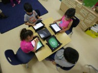 FILE - In this April 2, 2014 file photo, Pre-K students use electronic tablets at the South Education Center in San Antonio. As Gov. Rick Perry wraps up a record 14 years on the job, Republican Greg Abbott and Democrat Wendy Davis are both vowing to make public schools a …