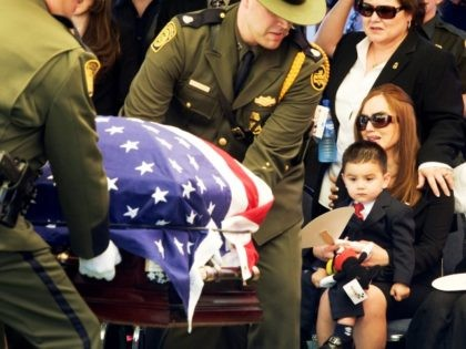 at the funerl service for Border Patrol Agent Robert W. Rosas in El Centro, Friday, July 31, 2009. Rosas was shot and killed while tracking suspected illegal immigrants or drug smugglers in a remote part of San Diego County. (AP Photo/Philip Scott Andrews)