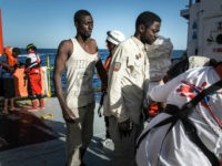 Migrants stand in line to register after being rescued aboard the MV Aquarius. 193 people and two corpses were recovered from a rubber boat by the MV Aquarius, a search and rescue vessel operated by MSF and SOS Mediterranee. Friday, Jan. 13, 2017. (AP Photo/Sima Diab)