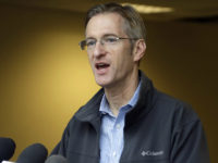 In this Jan. 17, 2017 photo, Portland Mayor Ted Wheeler speaks during a press conference in Portland, Ore. Wheeler is condemning the actions of some protesters after a May Day march took a violent turn in Portland Monday, May 1, 2017. (AP Photo/Don Ryan)