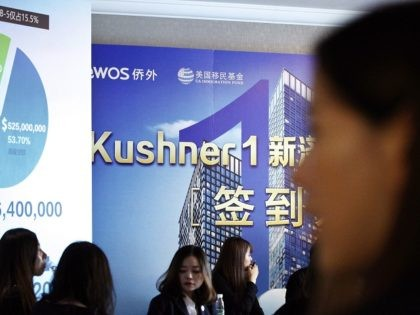 Chinese staff wait for investors at a reception desk during an event promoting EB-5 investment in a Kushner Companies development at a hotel in Shanghai, China, Sunday, May 7, 2017. The sister of President Donald Trump's son-in-law, Jared Kushner, has been courting Chinese investors using a much-criticized federal visa program …