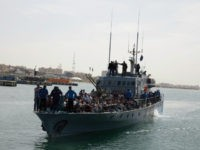 Migrants arrive at Abosetta base on Wednesday, May 10, 2017 in Tripoli, Libya. The Libyan coast guard has taken 300 migrants who were trying to reach Europe illegally by boat into custody, following an altercation with a volunteer rescue vessel. Ayoub Gassim, the spokesman for Libya's navy that is loyal …