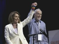Rep. Nancy Pelosi, D-Calif., and California Democratic Party Chairman John Burton raise their arms together in celebration during the California Democratic Party Convention in Sacramento, Calif., on Saturday, May 20, 2017. California Democrats had tough words for Republican President Donald Trump and the GOP Congress on Saturday as they continued …