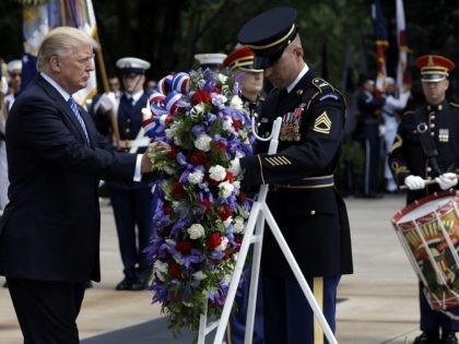 President Donald Trump participates in a wreath laying ceremony at Arlington National Cemetery, Monday, May 29, 2017, in Arlington, Va. (AP Photo/Evan Vucci)