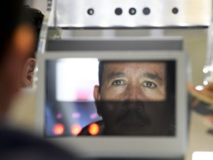 A pedestrian crossing from Mexico into the United States at the Otay Mesa port of entry has his facial features and eyes scanned at a biometric kiosk Thursday, Dec. 10, 2015, in San Diego. On Thursday, U.S. Customs and Border Protection began capturing facial and eye scans of foreigners entering …