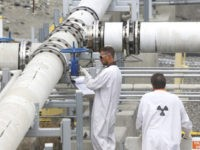 """FILE - In this July 9, 2014, file photo, workers wearing protective clothing and footwear inspect a valve at the """"C"""" tank farm during a media tour of the Hanford Nuclear Reservation Wednesday, July 9, 2014 near Richland, Wash. The U.S. Environmental Protection Agency is fining another federal agency up …"""