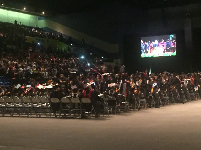 Many of the 300 graduates of historically black college Bethune-Cookman University turned their backs on U.S. Education Secretary Betsy DeVos as she gave her first commencement address since assuming her post.