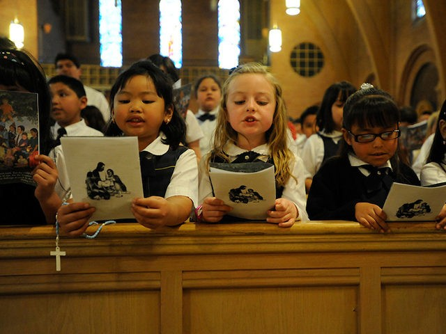 Catholic-School-Kids-Praying-Reuters