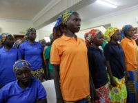 In this Monday, May 8, 2017 file photo, Chibok schoolgirls, recently freed from Nigeria extremist captivity, are photographed in Abuja, Nigeria. One of the Chibok schoolgirls kidnapped by Boko Haram in 2014 and who had the opportunity to be released on Saturday chose to stay with her husband, the spokesman …