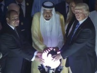 Donald Trump touching a glowing orb in Saudi Arabia.
