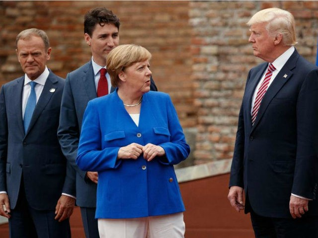 German Chancellor Angela Merkel talks with President Donald Trump during a family photo with G7 leaders at the Ancient Greek Theater of Taormina, during the G7 Summit, Friday, May 26, 2017, in Taormina, Italy. From left, European Council President Donald Tusk, Canadian Prime Minister Justin Trudeau, Merkel, and Trump. (AP …