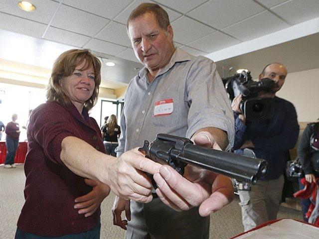WEST VALLEY CITY, UT - DECEMBER 27: A Utah teacher is shown how to handle a handgun by instructor Clint Simon (R), at a concealed-weapons training class to 200 Utah teachers on December 27, 2012 in West Valley City, Utah. The Utah Shooting Sports Council said it would waive its …