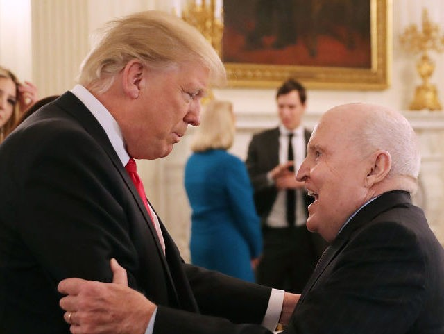 WASHINGTON, DC - FEBRUARY 03: U.S. President Donald Trump (L) greets former General Electric CEO Jack Welch at the beginning of a policy forum in the State Dining Room at the White House February 3, 2017 in Washington, DC. Leaders from the automotive and manufacturing industries, the financial and retail …