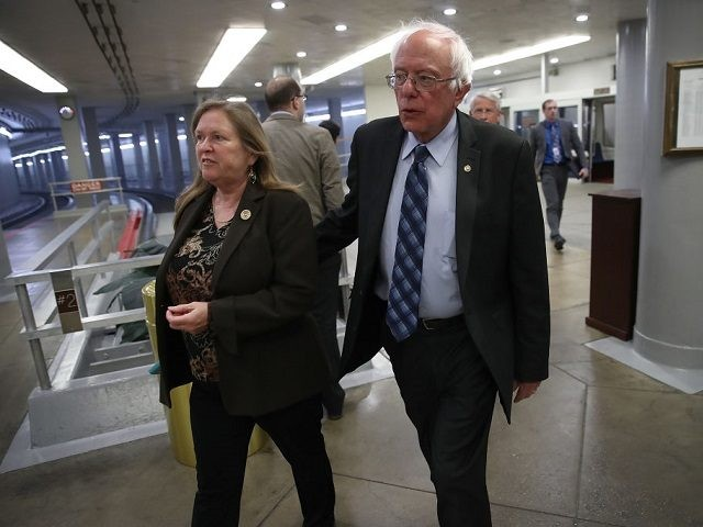 Sen. Bernie Sanders (I-VT) arrives with his wife Jane for the confirmation vote of Wilbur Ross for the position of Secretary of Commerce at the U.S. Capitol on February 27, 2017 in Washington, DC. Ross was confirmed by the Senate by a vote of 72-27. (Photo by Win McNamee/Getty Images) Restrictions