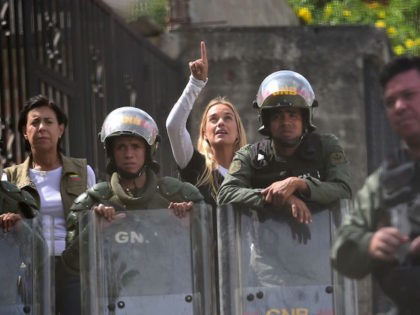 TOPSHOT - Jailed opposition leader Leopoldo Lopez's wife Lilian Tintori (C) and mother Antonieta Mendoza de Lopez (L) are stopped by the National Guard 500 metres from the entrance to the Ramo Verde penitentiary in Los Teques, 30 km east of Caracas, where Lopez is imprisoned, on April 28, 2017. …