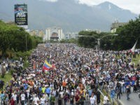 Demonstrators march along Francisco Fajardo highway in Caracas during a protest against Venezuelan President Nicolas Maduro, on May 3, 2017. Venezuela's angry opposition rallied Wednesday vowing huge street protests against President Nicolas Maduro's plan to rewrite the constitution and accusing him of dodging elections to cling to power despite deadly …