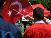 Pro-Erdogan supporters wave Turkish flags at anti government protesters in front of the White House in Washington,DC on May 16, 2017. Presidents Donald Trump and Recep Tayyip Erdogan stood side by side at the White House on Tuesday and promised to work through strained ties despite the Turkish leader's stern …