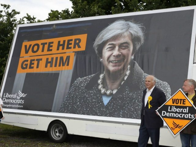 Liberal Democrat politician Vince Cable poses for a photograph after unveiling a campaign poster featuring a combined image of Nigel Farage and Theresa May at Twickenham Rugby Football Club in south west London on May 20, 2017. Cable, former Liberal Democrat Shadow Chancellor and former Business Secretary is looking to …