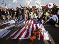 Yemeni supporters of the Huthi rebels burn Israeli and US flags as they shout slogans against the United States during an anti-US protest in Sanaa on May 20, 2017. US President Donald Trump began an official visit to Saudi Arabia, which for more than two years has led a coalition …