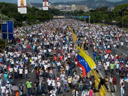 Opposition activists block the Francisco Fajardo main motorway in eastern Caracas on May 20, 2017 to protest against President Nicolas Maduro. Venezuelan protesters and supporters of embattled President Nicolas Maduro take to the streets Saturday as a deadly political crisis plays out in a divided country on the verge of …