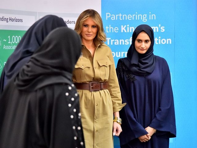 First Lady Melania Trump (C) poses for a picture with employees during a visit to the GE All-Women Business Process Services and IT Centre on May 21, 2017, in the Saudi capital Riyadh. / AFP PHOTO / GIUSEPPE CACACE (Photo credit should read GIUSEPPE CACACE/AFP/Getty Images)