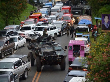 An armoured personnel carrier manuevers past gridlocked vehicles of residents fleeing Marawi City, in southern island of Mindanao on May 25, 2017, as fighting between Muslim extremists and government forces rages. Philippine security forces bombed residential areas in a southern city on May 25 as they battled Islamist militants who …