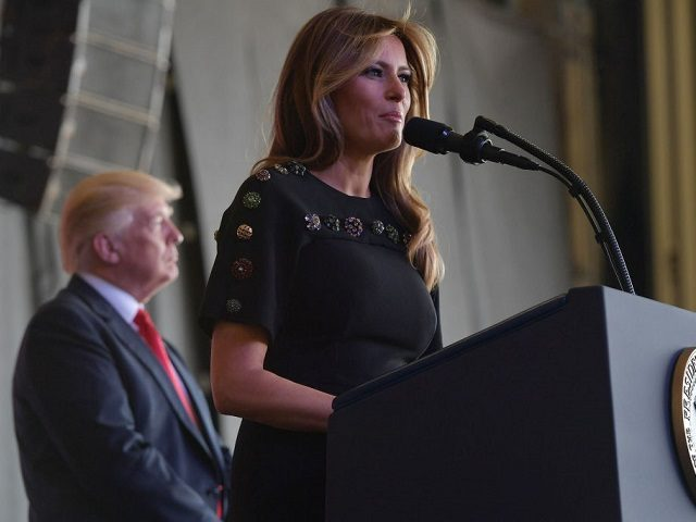 US First Lady Melania Trump address US military personnel and families at Naval Air Station Sigonella as US President Donald Trump stands on stage, after G7 summit of Heads of State and Government, on May 27, 2017 near Taormina in Sicily. / AFP PHOTO / MANDEL NGAN (Photo credit should …