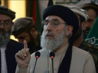 Afghan warlord and ex-prime minister Gulbuddin Hekmatyar gestures as he speaks at a rally in Jalalabad, the capital of Nangarhar province, on April 30, 2017. Hekmatyar has returned to public life after more than 20 years in exile, calling on the Taliban to lay down their weapons and join a 'caravan of peace'. Hekmatyar, white-bearded and clad in his trademark black turban, spoke to supporters at a gathering in Laghman province widely broadcast in Afghanistan, where his return to the political mainstream months after etching a landmark peace deal with Kabul has been hugely controversial. / AFP PHOTO / NOORULLAH SHIRZADA (Photo credit should read NOORULLAH SHIRZADA/AFP/Getty Images)