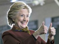 Hillary thumbs up Mary AltafferAP