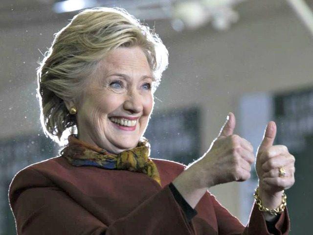 Hillary thumbs up Mary AltafferAP