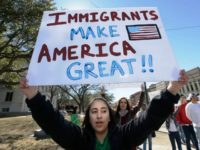 Immigrants with Immigrants Make America Great sign