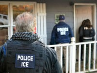 In this Feb. 9, 2017, photo provided U.S. Immigration and Customs Enforcement, ICE agents at a home in Atlanta, during a targeted enforcement operation aimed at immigration fugitives, re-entrants and at-large criminal aliens. The Homeland Security Department said Feb. 13, that 680 people were arrested in roundups last week targeting immigrants living illegally in the United States. (Bryan Cox/ICE via AP)