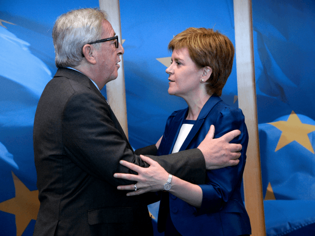 European Union Commission President Jean-Claude Juncker (L) welcomes Scotland's First Minister and Leader of the Scottish National Party Nicola Sturgeon before their meeting at the European Union Commission headquarter in Brussels, June 29, 2016. (Photo by THIERRY CHARLIER/AFP/Getty Images)